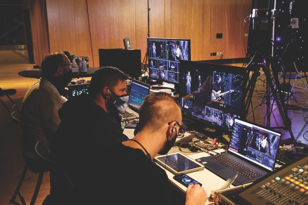 A crew of six technicians, including mobile camera operators, are needed to run lights, video, and sound for Excellence in the Community's live-streamed concerts.