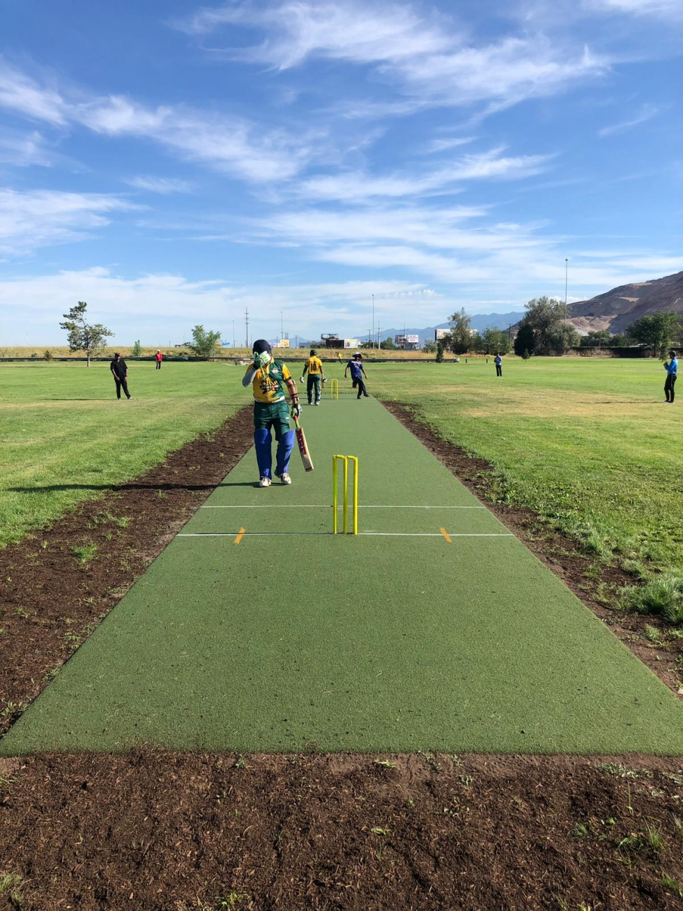 Local cricket teams, Utah Lions v. Salt Lake Knights, take advantage of the new cricket pitch at Rosewood Park last August.  Photo by Fahad Rana